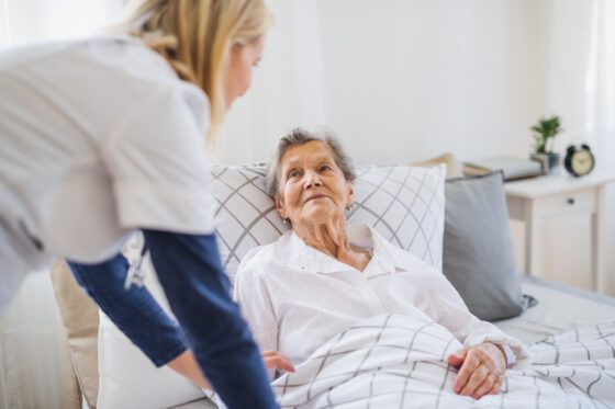 Private Home Care in Pittsburgh, PA attending to elderly woman in her bed at home